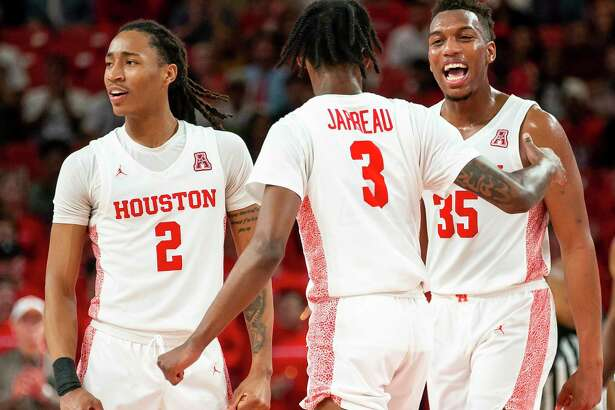 Caleb Mills, from left, DeJon Jarreau and Fabian White Jr. have helped UH achieve a national ranking for the third consecutive season.