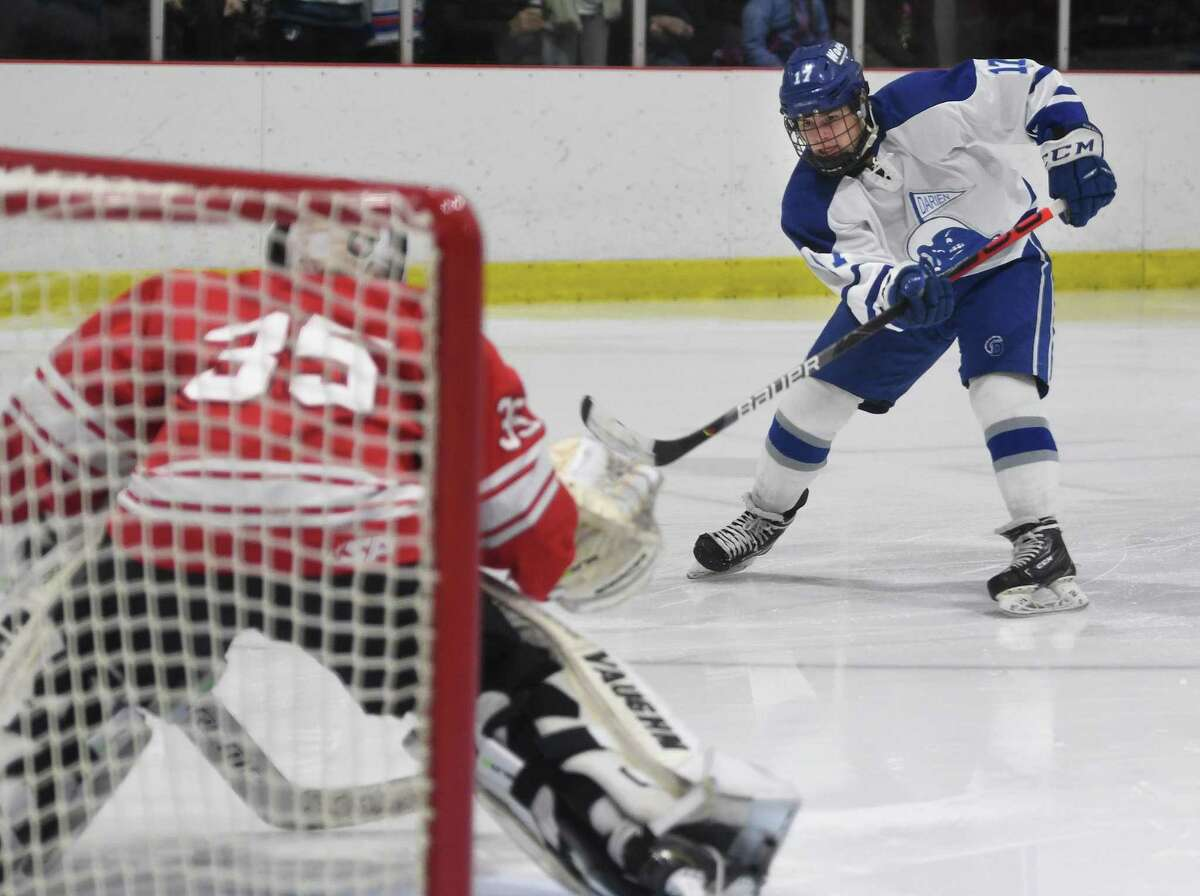 Darien's Jamison Moore shoots on the breakaway during the second period of their boys hockey game with Fairfield Prep at the Darien Ice Rink in Darien, Conn. on Monday January 19, 2020.