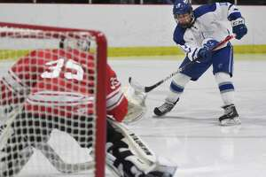 Darien's Jamison Moore shoots on the breakaway during the second period of Monday's 6-3 win over Fairfield Prep at the Darien Ice House.