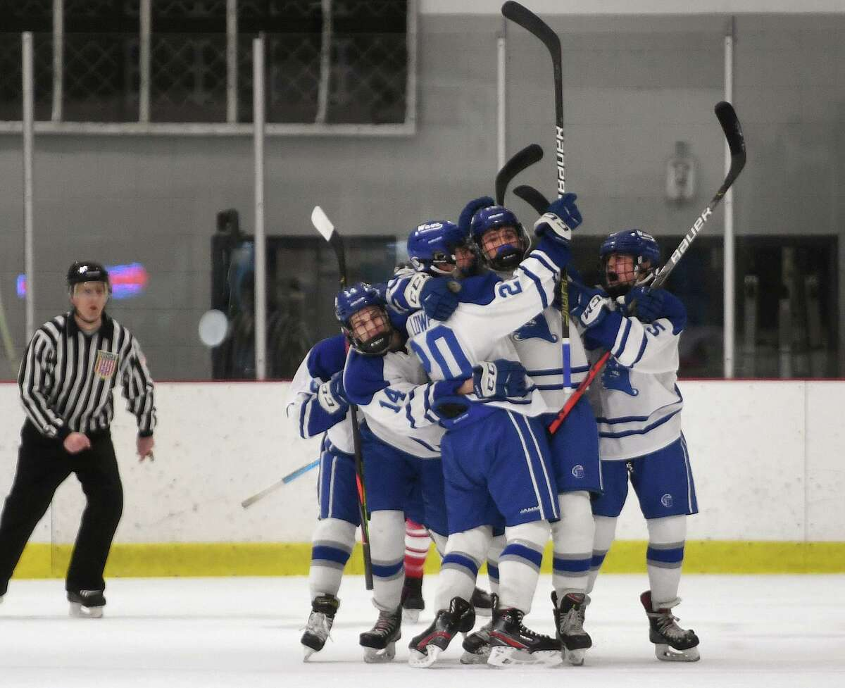 Darien players celebrate one of their four first period goals during their Monday's win over Fairfield Prep at the Darien Ice House on Monday.