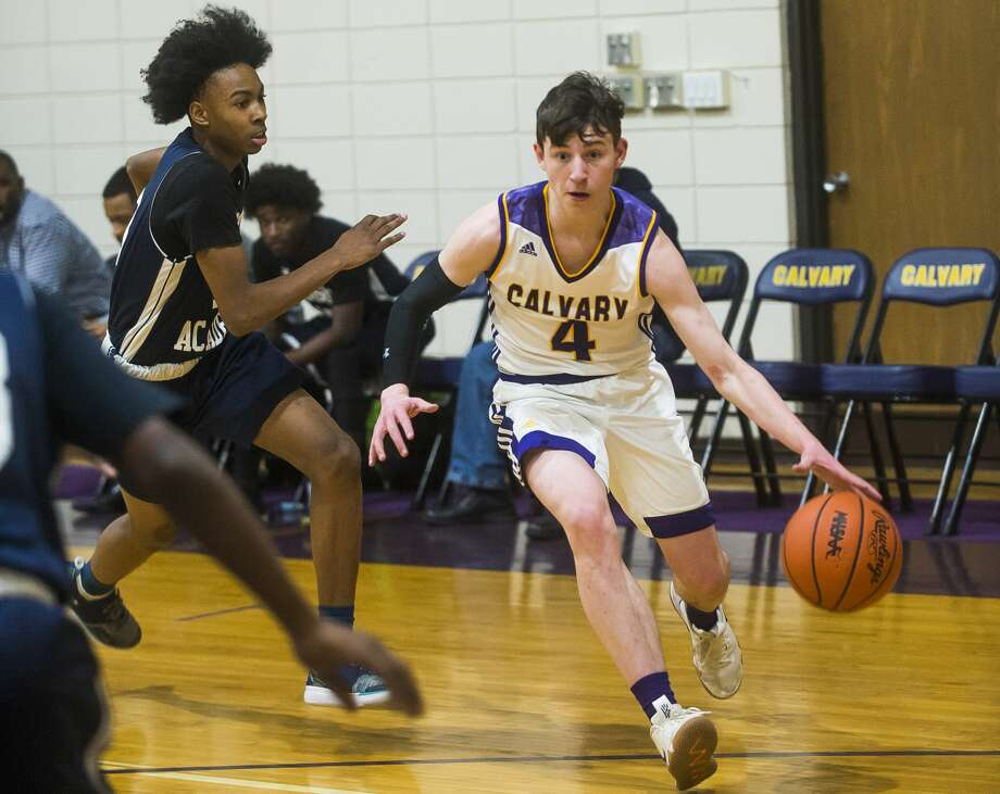 Calvary Baptist's Nate Wiggins dribbles down the court during a game against Madison Academy Monday, Jan. 20, 2020 at Calvary Baptist Academy. (Katy Kildee/kkildee@mdn.net) Photo: (Katy Kildee/kkildee@mdn.net)