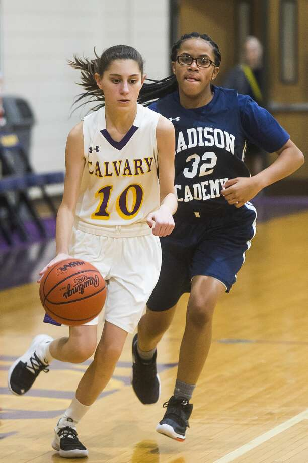 Calvary Baptist's Caroline Houtman dribbles down the court during a game against Madison Academy Monday, Jan. 20, 2020 at Calvary Baptist Academy. (Katy Kildee/kkildee@mdn.net) Photo: (Katy Kildee/kkildee@mdn.net)