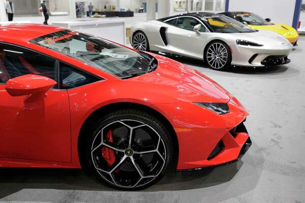 Lamborghinis and McLarens in the North Houston dealership exhibit during set up for the Houston Auto Show at the NRG Center Monday, Jan. 20, 2020 in Houston, TX.