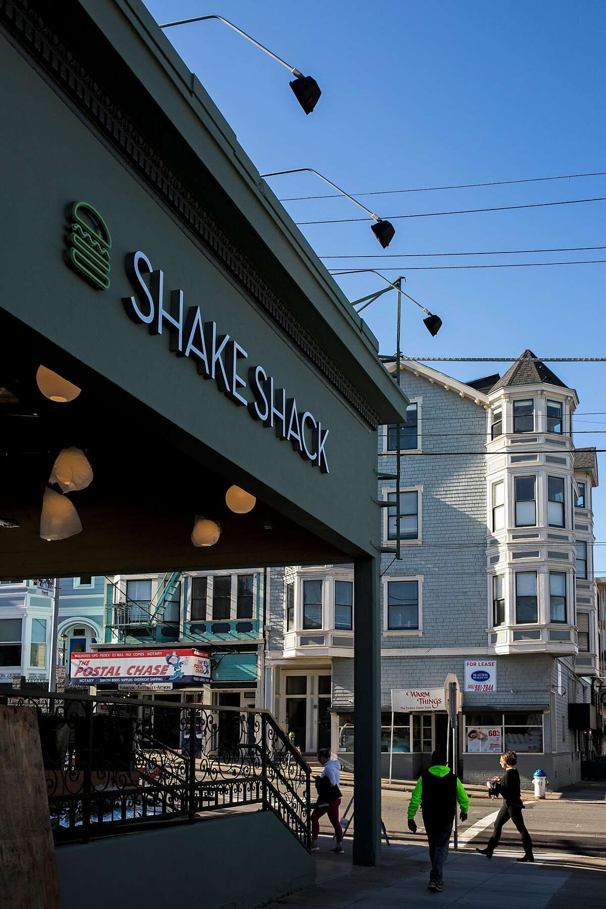 People outside the Shake Shack located at 3060 Fillmore Street on Thursday, Dec. 26, 2019, in San Francisco, Calif.