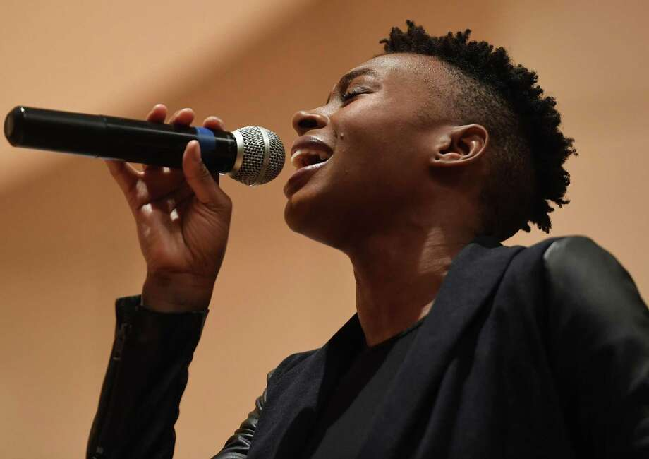 """Guest soloist Riki Stevens, of Norwalk, performs """"Jesus You Are Lord"""" at the Martin Luther King Jr. Day commemoration at City Hall in Norwalk on Monday. Inside: Westport marks MLK Day at playhouse. A3 Photo: Brian A. Pounds / Hearst Connecticut Media / Connecticut Post"""