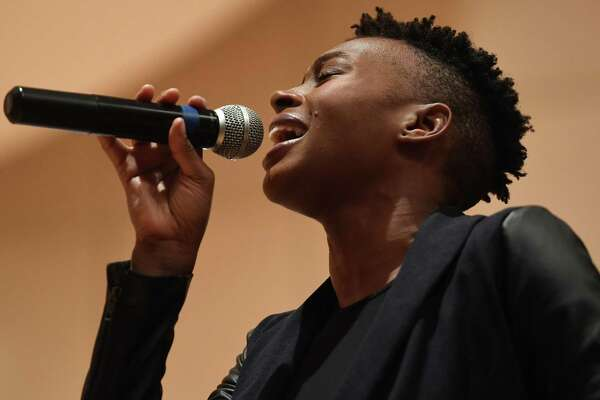 "Guest soloist Riki Stevens, of Norwalk, performs ""Jesus You Are Lord"" at the Martin Luther King Jr. Day commemoration at City Hall in Norwalk on Monday. Inside: Westport marks MLK Day at playhouse. A3"