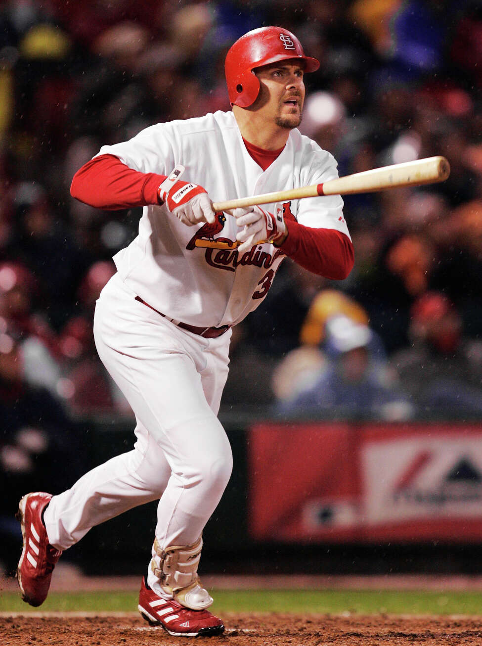 FILE - In this Oct. 14, 2004, file photo, St. Louis Cardinals' Larry Walker watches his two-run home run off Houston Astros pitcher Pete Munro in the fifth inning of Game 2 of the National League Championship Series in St. Louis. Walker is on the 2020 Hall of Fame ballot. On Tuesday, Jan. 21, 2020, the Baseball Writers' Association of America will announce the results of its 2020 Hall of Fame balloting. (AP Photo/Al Behrman, File)