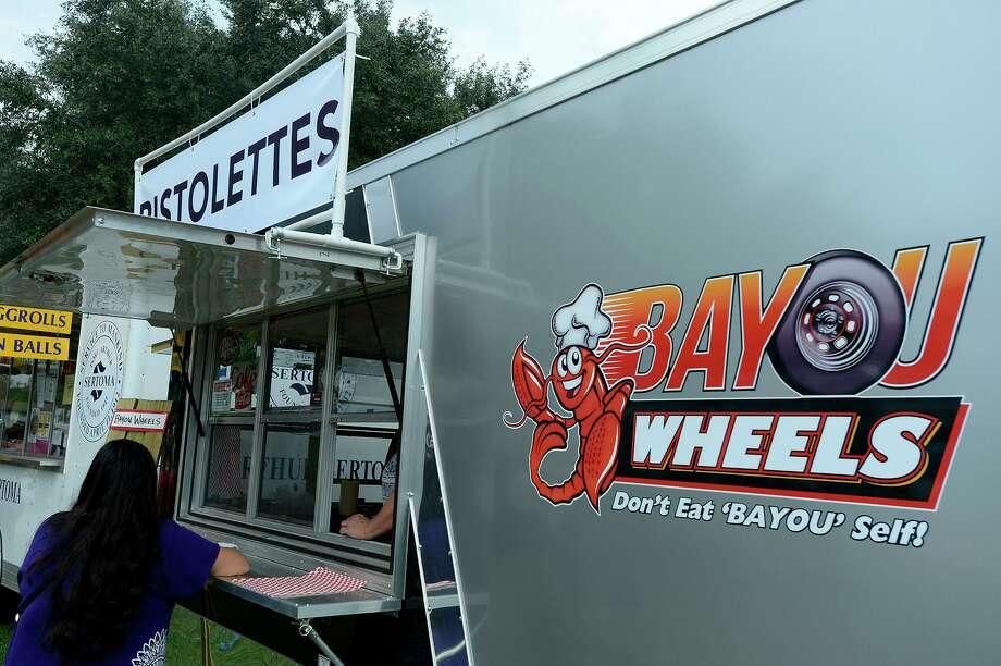 The Bayou Wheels food truck set up at the Groves Pecan Festival on Saturday.   Photo taken Saturday 11/5/16 Ryan Pelham/The Enterprise Photo: Ryan Pelham / Ryan Pelham/The Enterprise / ©2016 The Beaumont Enterprise/Ryan Pelham