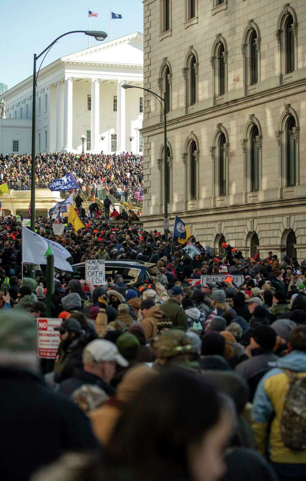 Gun-rights advocates fill the streets surrounding the Virginia State Capitol in Richmond, Va., Monday, Jan. 20, 2020. (Mike Morones/The Free Lance-Star via AP)