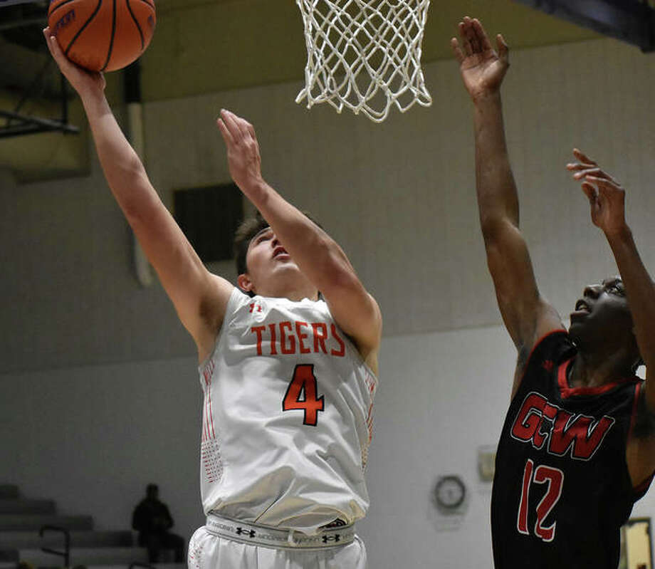 Edwardsville forward Nic Hemken goes up for a shot during the first half against Granite City on Monday in the Jersey Mid-Winter Classic. Photo: Matt Kamp|The Intelligencer