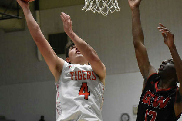 Edwardsville forward Nic Hemken goes up for a shot during the first half against Granite City on Monday in the Jersey Mid-Winter Classic.