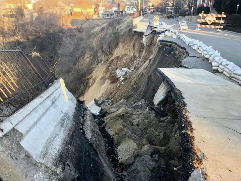 """Local photographer Matt Kelly captured these photos of the result of Sunday night's partial wall collapse in Riverview Park. """"A little scary,"""" he said about the scene. Photo: Matt Kelly 