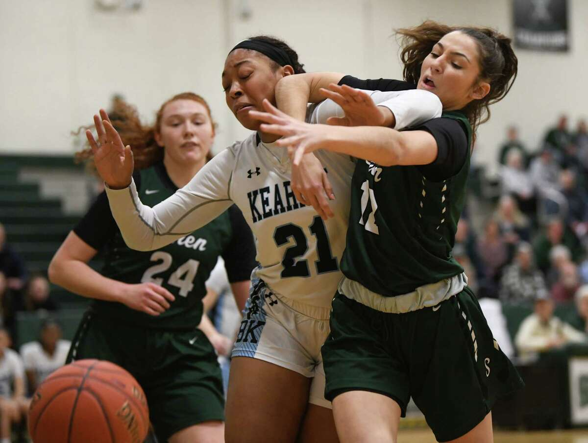 Bishop Kearney's Saniaa Wilson, #21, and Shenendehowa's Rylee Carpenter battle for a rebound during a game on Monday, Jan. 20, 2020 in Clifton Park, N.Y. (Lori Van Buren/Times Union)