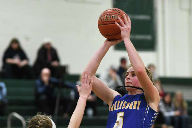 Queensbury's Hailey Ballard is guarded by Our Lady of Lourdes' Ava Learn as she goes up for a jump shot during a game on Monday, Jan. 20, 2020 in Clifton Park, N.Y. (Lori Van Buren/Times Union)