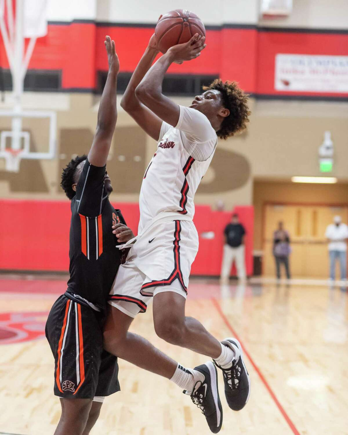 Titans' Amaree Abram (1) gets off an inside shot as Port Arthur Memorial downed Pious X in first round action of the 27th Gamble Classic onThursday, December 26, 2019. Fran Ruchalski/The Enterprise