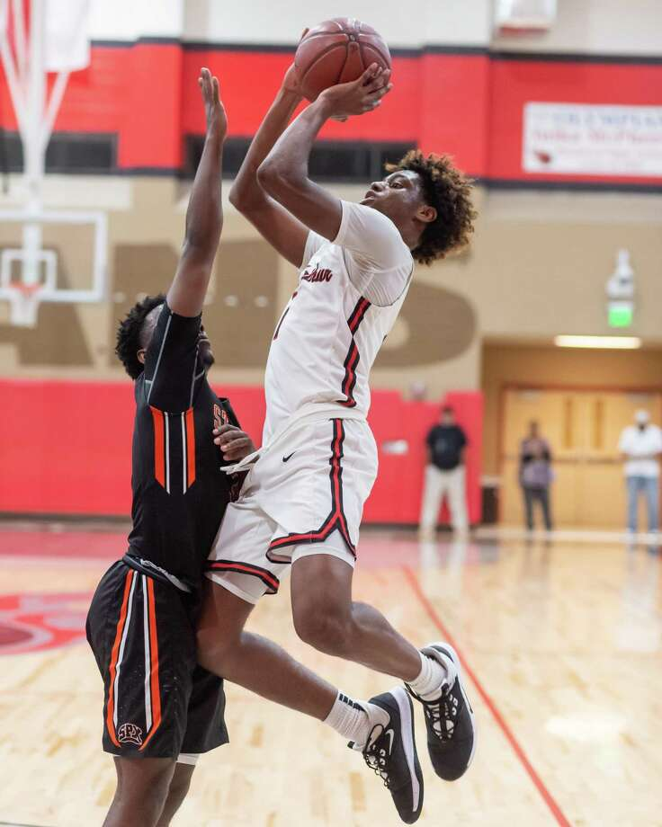 Titans' Amaree Abram (1) gets off an inside shot as Port Arthur Memorial downed Pious X in first round action of the 27th Gamble Classic onThursday, December 26, 2019. Fran Ruchalski/The Enterprise Photo: Fran Ruchalski/The Enterprise