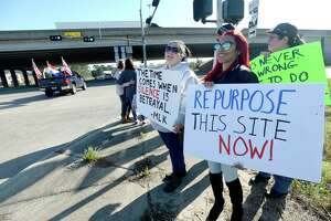 Protesters, including (from left) Marsi Patronella, Jacqueline Hernandez and Kelli Patin, gather with signs outside the Confederate Memorial of the Wind in Orange on Martin Luther King Day to express their beliefs about the site and its message. The event was organized by the group Repurpose Memorial. Photo taken Monday, Jan. 20, 2020 Kim Brent/The Enterprise