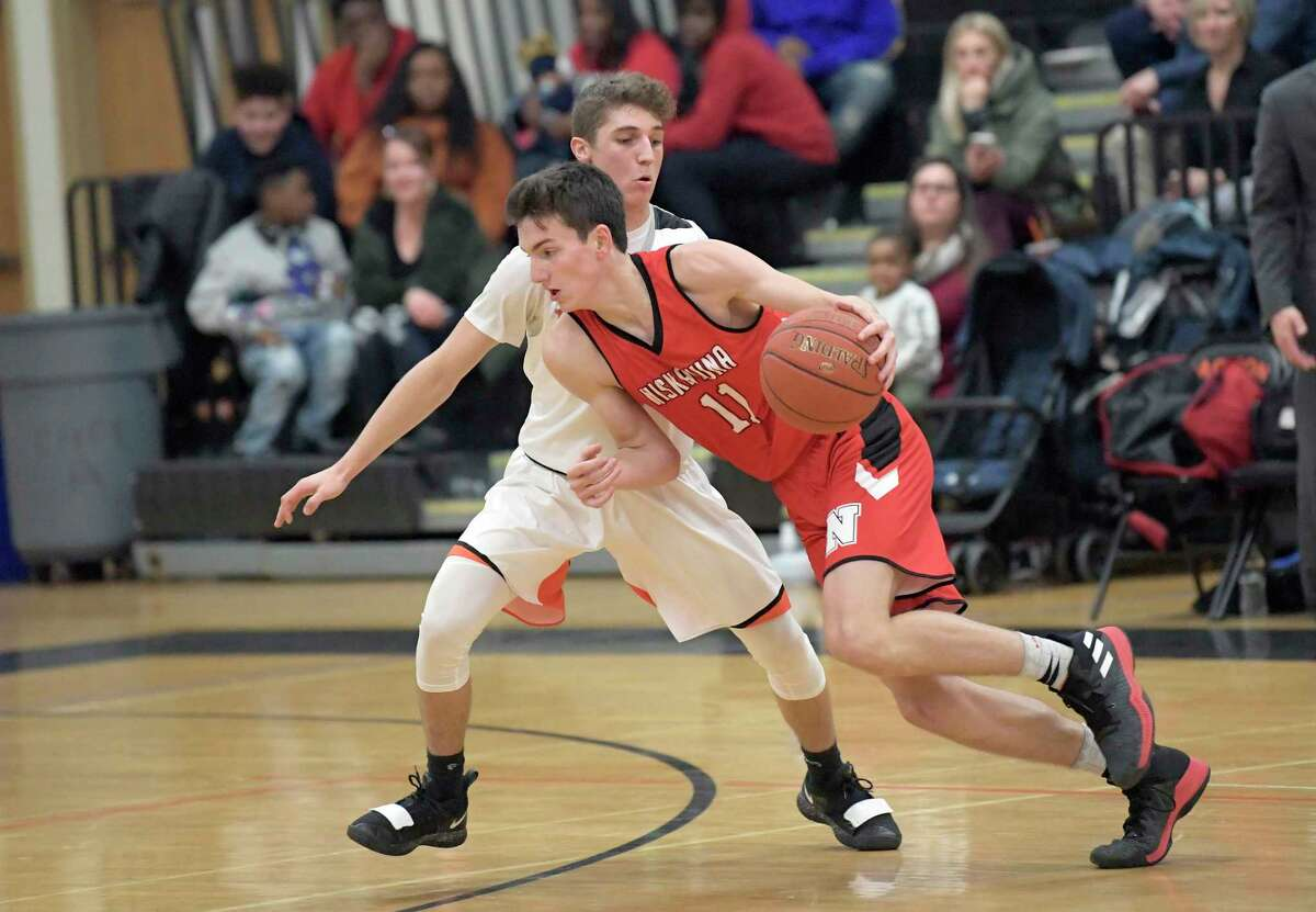 Niskayuna's Ethan St lucia (11)moves the ball against Mohonasen during a Section II high school basketball game Friday, Dec. 27, 2019, in Rotterdam, N.Y. (Hans Pennink / Special to the Times Union) ORG XMIT: 122819_hsbb2_HP112