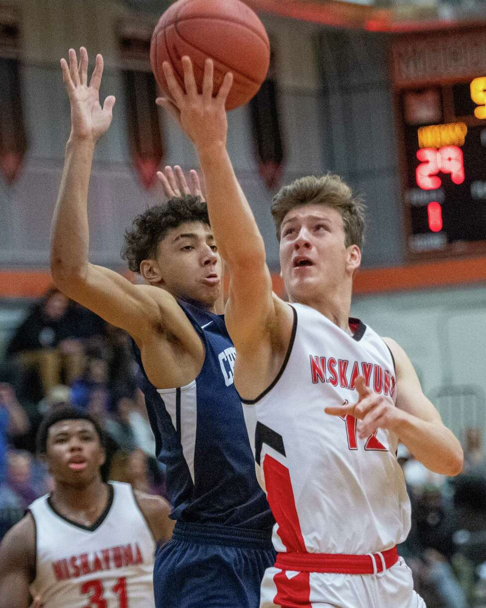 Niskayuna senior Sean St. Lucia lays one in in front of Mekeel Christian senior Richard Rollins during the finals of the Kirvin Cup at Mohonasen High School on Saturday, Dec. 28, 2019 (Jim Franco/Special to the Times Union.)