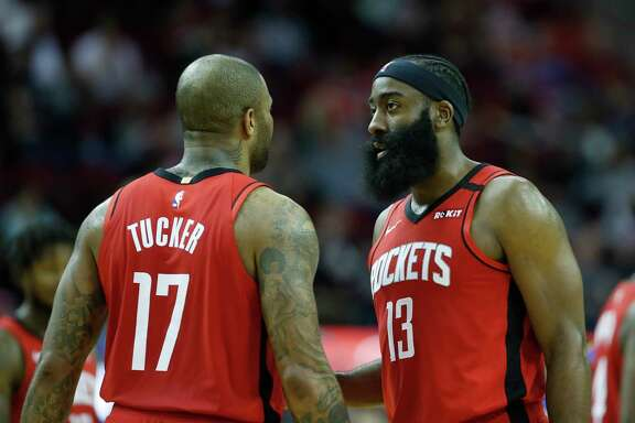 Houston Rockets guard James Harden (13) and  forward P.J. Tucker (17) chat during the second half of an NBA basketball game at Toyota Center, in Houston, Monday, Jan. 20, 2020.
