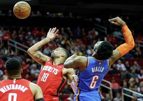 Houston Rockets forward Thabo Sefolosha (18) and Oklahoma City Thunder guard Hamidou Diallo (6) reach for a loose ball during the second half of an NBA basketball game at Toyota Center, in Houston, Monday, Jan. 20, 2020.