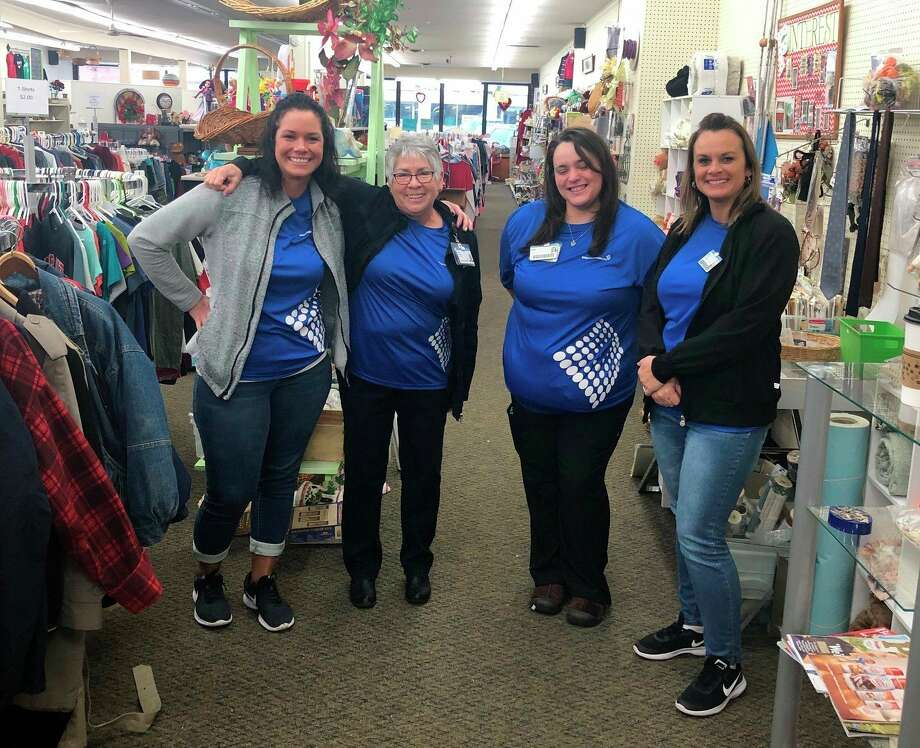 Spectrum Health Big Rapids and Reed City Hospital employees, from left, Katie Leusby, Lorie Mcleod, Robin Galloup and Anna Smits volunteered Monday at the Inc Spot resale shop in Reed City. (Courtesy photo)