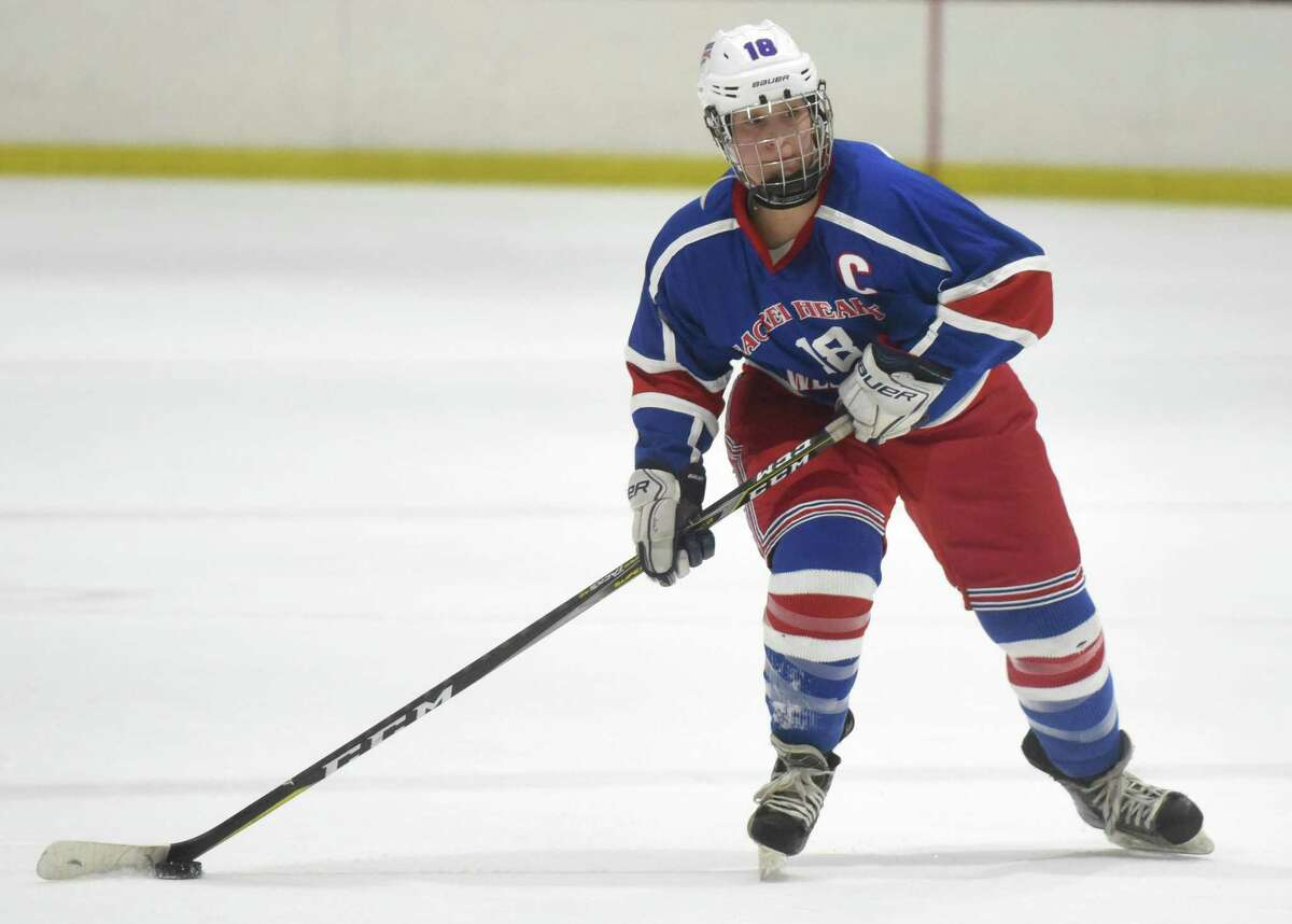 West Haven/SHA's Brooke McNabola looks to score against New Canaan at the Darien Ice House in January.