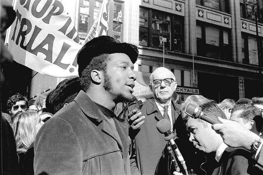 "Fred Hampton (center), chairman of the Illinois Black Panther party, speaks at a 1969 rally outside the U.S. Courthouse in Chicago while Benjamin Spock (background) listens. ""The First Rainbow Coalition,"" a new PBS documentary, is exploring a little-known movement in 1960s Chicago that brought together blacks, Latinos and poor whites from Appalachia that later resulted in the upending of politics in the Midwest. Photo: ESK 