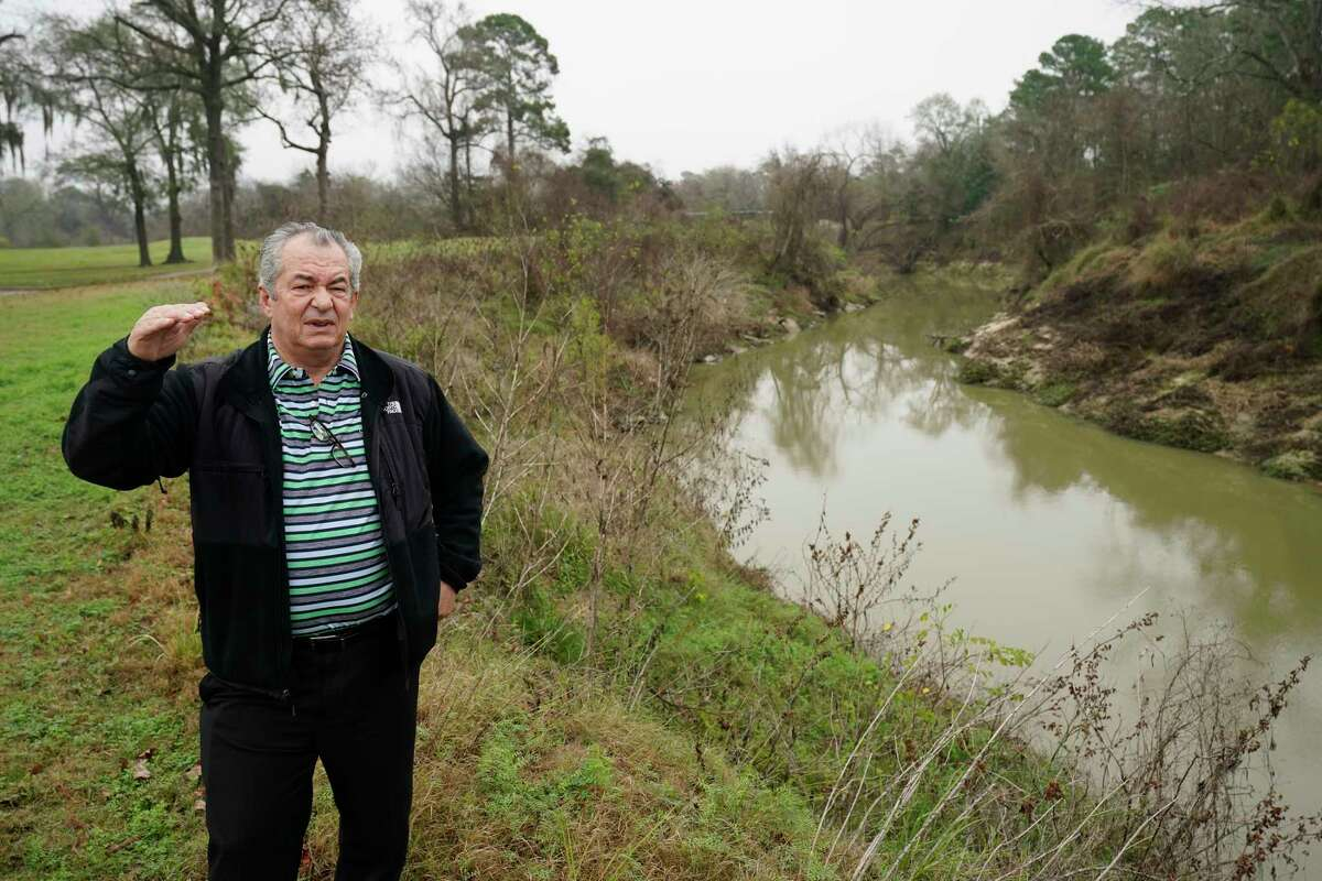 Lou Mills, marketing director, stands by Cypress Creek that borders Raveneaux County Club, 9415 Cypresswood Dr., as he talks about flooding Friday, Jan. 17, 2020, in Spring. As the Harris County Flood Control District looks for more sites to store storm water in flood events, it is increasingly turning to golf courses. The county is preparing to purchase part of Raveneaux Country Club along Cypress Creek for a detention basin.