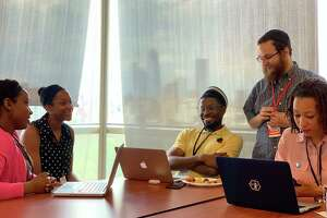 Flatiron School is offering scholarships to people historically underrepresented in technology, including women, minorities, veterans and those with disabilities.