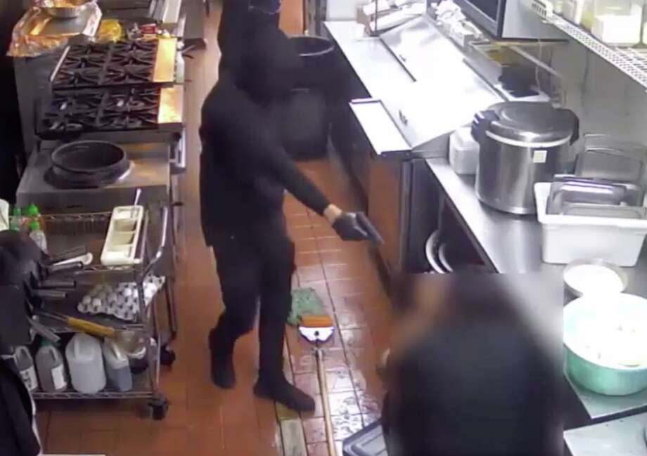 A group of robbers are seen on surveillance video as they steal nearly $30,000 from a restaurant Jan. 7, 2020. Photo: Houston Police Department