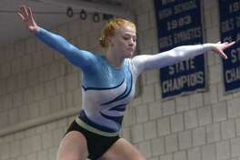 Sarah Collias and the Wilton gymnastics team beat Greenwich to improve their record to 4-1.