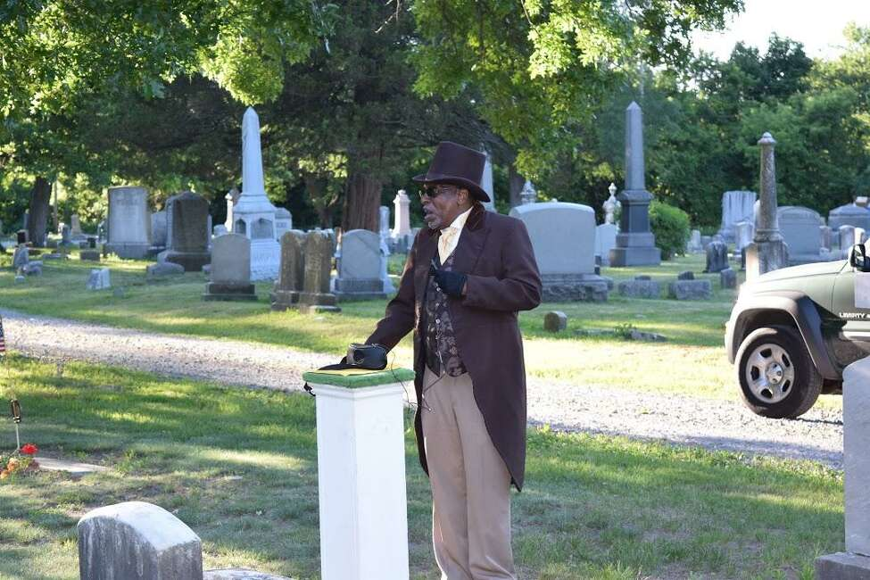 Actor Walter Simpkins will portray Moses Viney, as he does here at Vale Cemetery, at Saturday's program