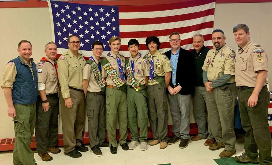 The Eagle Court of Honor — Former Scoutmaster Robert Cohen, current Scoutmaster Michael Towell, Tavo Reynoso, Eagle Scouts Alejandro Ross, Jack Holly, Alex Gu, and Quinlan Daly, former Scoutmasters Chris Hagen, Pat Gentile, Santo Golino, and Kevin Granath. Photo: Susan Daly