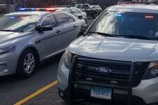 Connecticut State Police vehicles on I-84 in Danbury.