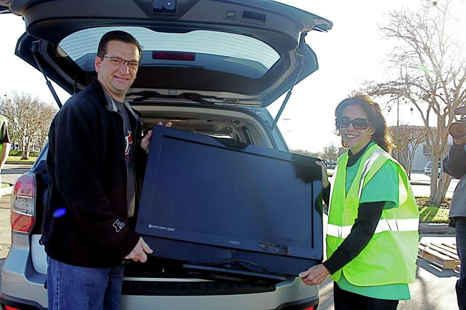 In celebration of America Recycles Day, Missouri City Green & The City of Missouri City are hosting an Electronic Recycling Event on Saturday from 9 a.m.-noon at the Missouri City Public Safety Headquarters,3849 Cartwright Road. Helping out at an earlier America Recycles Day are, from left, Missouri City City Councilman Anthony Maroulis and Diane Giltner of Missouri City Green. Photo: Suzanne Rehak, Freelance Photographer / For The Chronicle