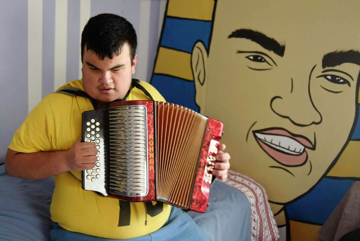 David Tovar, 17, sings opera and plays the accordion at his home in the Glenville section of Greenwich, Conn.  Blind Greenwich teen defies the odds as a talented musician  In July 2002, David Tovar was born 16 weeks early, weighing just 1 pound and 1 ounce. He spent the first few years of his life in and out of the hospital, undergoing ear, eye, heart, trachea and hernia surgeries. It seemed every time he got better, another health issue would arise. At age 4, David took up the violin.
