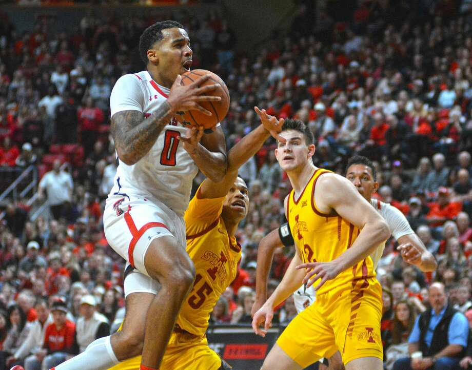 Texas Tech's Kyler Edwards drives into the lane past Iowa State defenders Rasir Bolton (45) and Michael Jacobson during their Big 12 Conference men's basketball game on Saturday afternoon in the United Supermarkets Arena. Photo: Nathan Giese/Planview Herald