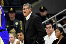 UConn coach Geno Auriemma shouts instructions during the first half against Tulsa Sunday in Storrs.