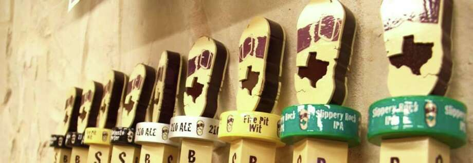 A line of beer taps featuring brews from San Antonio's Busted Sandal Brewing Co. Photo: Busted Sandal Brewing Co.