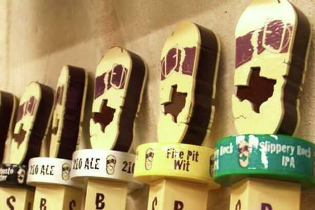 A line of beer taps featuring brews from San Antonio's Busted Sandal Brewing Co.