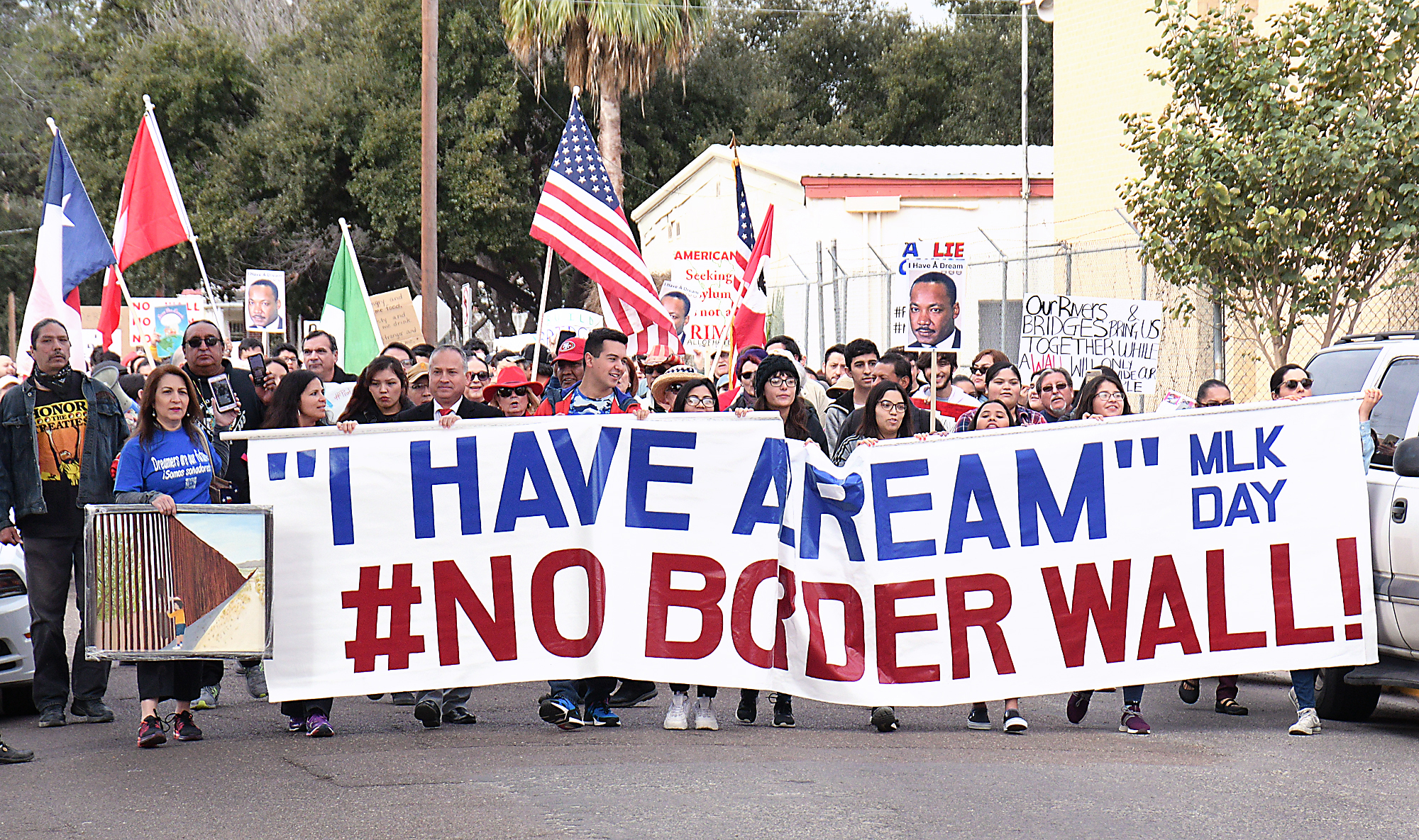 Hundreds of locals march against border wall on MLK Day