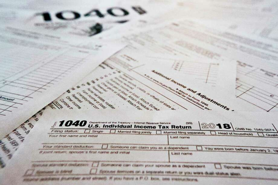 FILE - This Feb. 13, 2019 file photo shows multiple forms printed from the Internal Revenue Service web page. (AP Photo/Keith Srakocic) Photo: Keith Srakocic / Associated Press / Copyright 2019 The Associated Press. All rights reserved