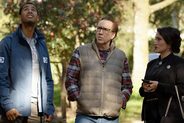 """(L-R) Elliot Knight as Ward Phillips, Nicolas Cage as Nathan Gardner and Q'orianka Kilcher as Mayor Tooma in the sci-fi / horror film, """"COLOR OUT OF SPACE."""""""
