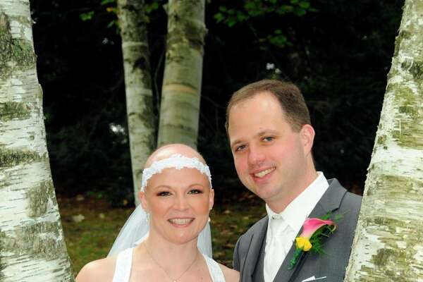 On Sept. 13, 2014, Matthew and Rachael Christianson were married. Rachael was diagnosed with cancer in May 2014, and had been in the process of receiving chemotherapy treatments. She made her veil into a headband so she could still wear it to her wedding. (Photo provided)