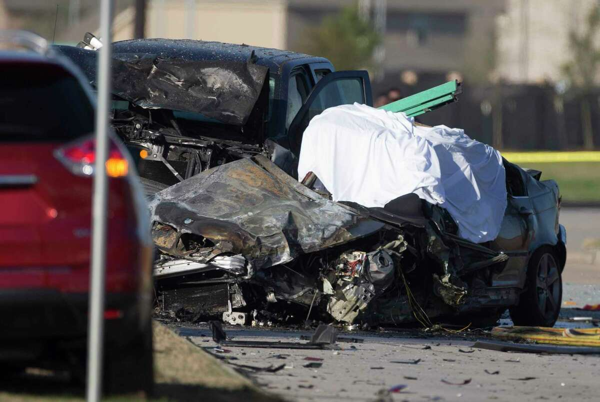 Harris County Sheriff's Office deputies investigate a three-vehicle crash that left one driver dead near the intersection of West and Greenhouse Roads on Jan. 21, 2020, in Cypress.