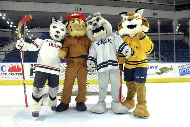 UConn's Johnathan the Husky, Sacred Heart's Big Red the Pioneer, Yale's Boola the Bulldog and Quinnipiac's Boomer the Bobcat, the four mascots from Connecticut universities participating in the Connecticut Ice gather on the ice at Webster Bank Arena in Bridgeport on Dec. 16, 2019.