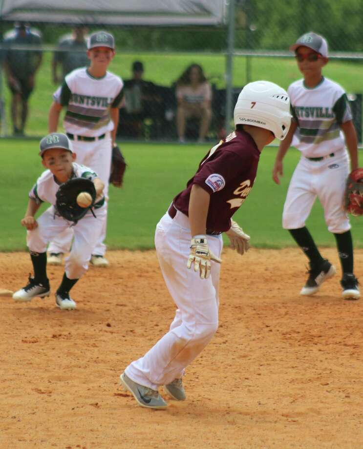 Kids who sign up for the baseball season will have the excitement of getting caught in a rundown, hoping the defense drops the ball. Photo: Robert Avery