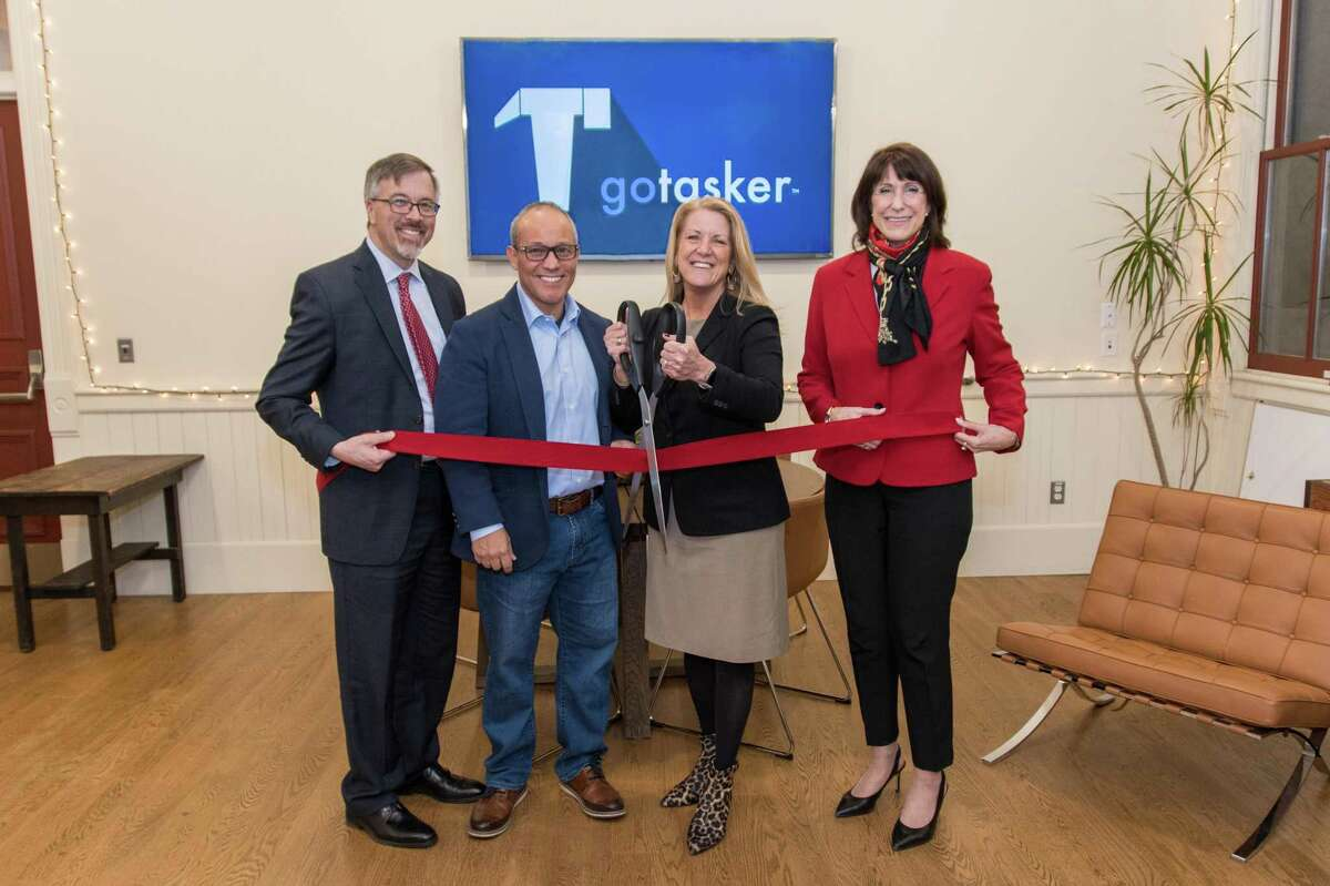 Cutting the ribbon, from left, are Mark Barnhart, Fairfield Community and Economic Development Director; goTasker owner Frank Festini; First Selectwoman Brenda Kupchick; and Beverly Balaz, Fairfield Chamber of Commerce president.
