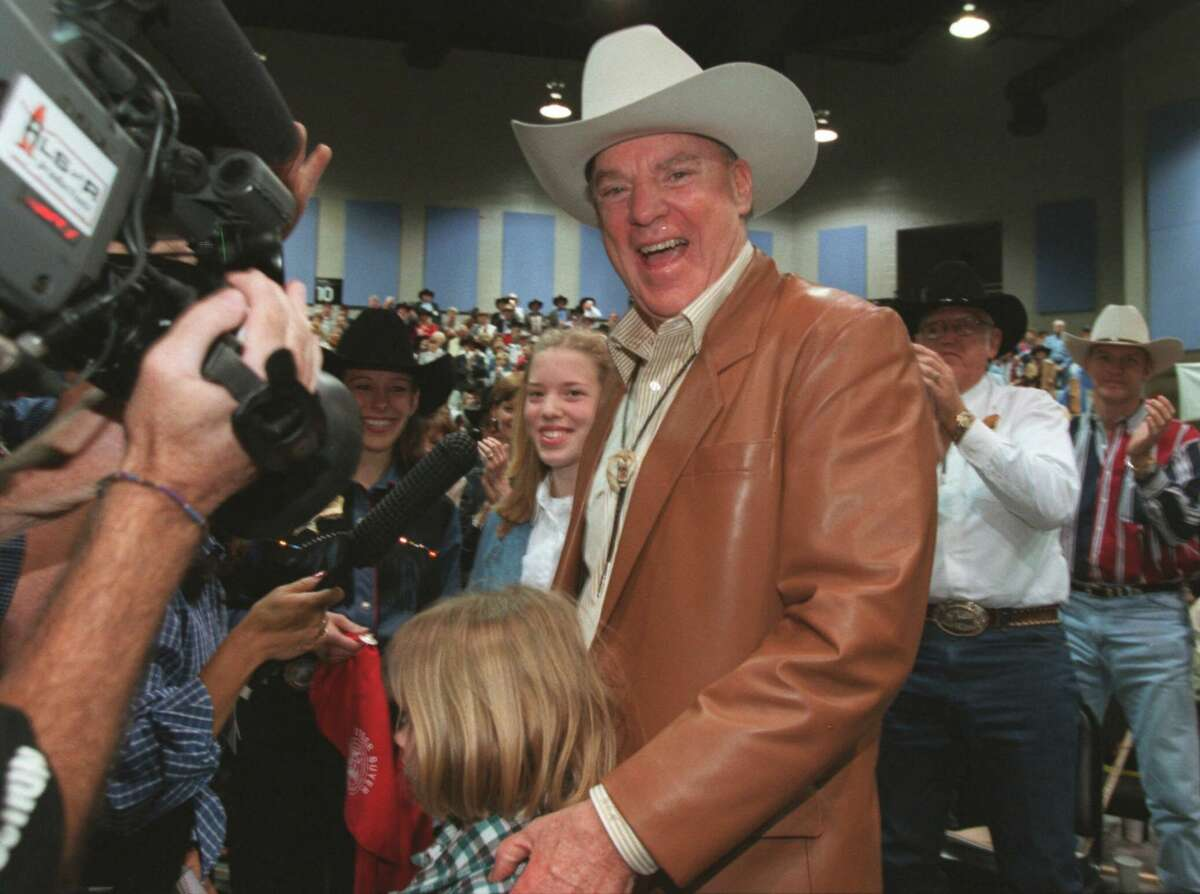 Bob McNair smiles for the media after he and his wife, Janice McNair, (not shown) made a record-winning bid of $560,000 for Star, the Grand Champion Steer on Saturday, March 4, 2000, at the Junior Market Steer Auction at the Houston Livestock Show and Rodeo in Houston. Star is a 1,279-pound Chianina owned by Clayton Parker, 17, of Uvalde, Texas. (AP Photo/Houston Chronicle, Buster Dean)